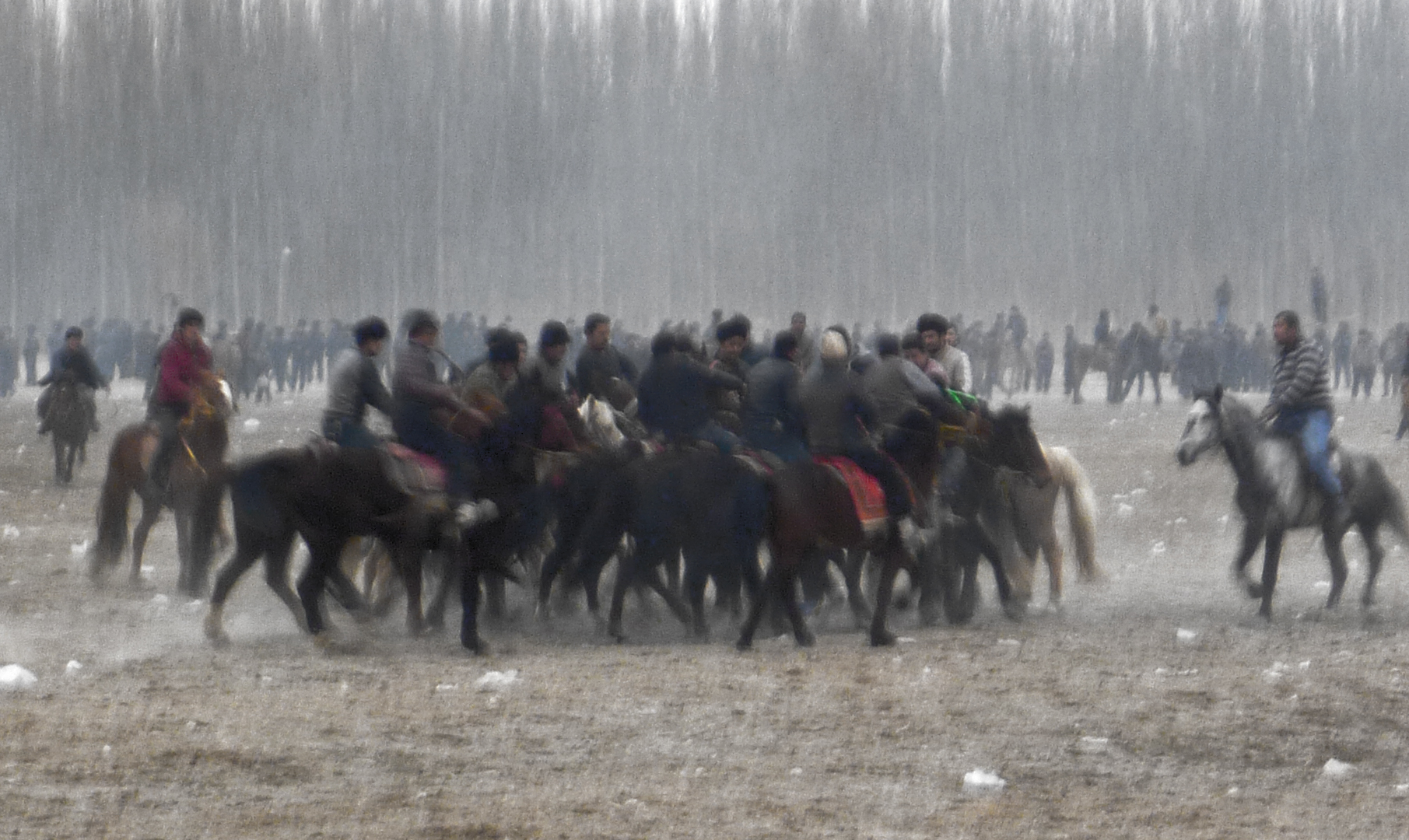 "Uyghurs near the city of Khotan at a weekly ""Goat Pulling"" (Oglaq-tatish) competition in 2015. Image by Darren Byler"